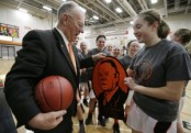 Waukon's Eli Ronan (right) presents head coach Gene Klinge with a metal plaque during a ceremony celebrating his 1,000th win after their girl's basketball game against MFL Mar Mac at Waukon High School on Thursday, Jan. 31, 2013, in Waukon, Iowa. Waukon won, 88-60. (Jim Slosiarek/Gazette-KCRG)