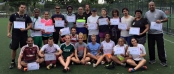 While displaying her Peacock pride, Upper Iowa red shirt junior Savannah Schinto (front, middle) is pictured with other adult volunteers/coaches at the recent Coaches Across Continents mission in Brazil.