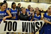 VIOREL FLORESCU/THE RECORD PHOTOGRAPHER Holy Angels coach Sue Liddy and her players celebrating Thursday, Jan. 14. She took the opportunity to pay tribute to all her players over the past 41 years.