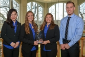 Upper Iowa University Enactus Chapter members (l-r) E Jing Heng, Taylor Klosterman, Gabriel Wittenburg and Dustin Hoefs display the Champion's trophy that the participating UIU students recently earned during the regional Enactus competition in Chicago, Ill. UIU Enactus team member Jason McClenahan is not pictured. The UIU students now advance to the 2015 Enactus United States National Exposition, which will be held in St. Louis, Mo., May 15-17. Enactus students apply business concepts to develop community outreach projects with the primary goal to shape a more sustainable world.