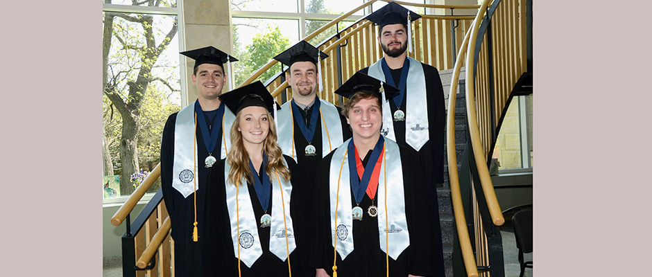 The first graduates of the Upper Iowa University Csomay Honors Program were (front) Sydney Cyzon, DePere, Wis.; William Kenney, Coon Rapids, Minn.; (back, l-r) Dustin Osier, Greene, Iowa; Bradley Kuboushek, Calmar, Iowa; Lucas Braun, Jesup, Iowa.