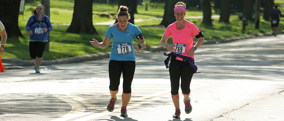 During her attempt to run road races in all 50 states, alumna  Jenni Thompson (right) has been joined in nine events by her friend and former fitness class instructor Kristin Day.