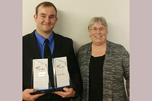 Upper Iowa University graduate   and PBL (Phi Beta Lambda) National Leadership award winner Bradley Kuboushek was congratulated by UIU-PBLChapter adviser Lynn Isvik following the recent PBL National Leadership Conference in Atlanta, Ga.