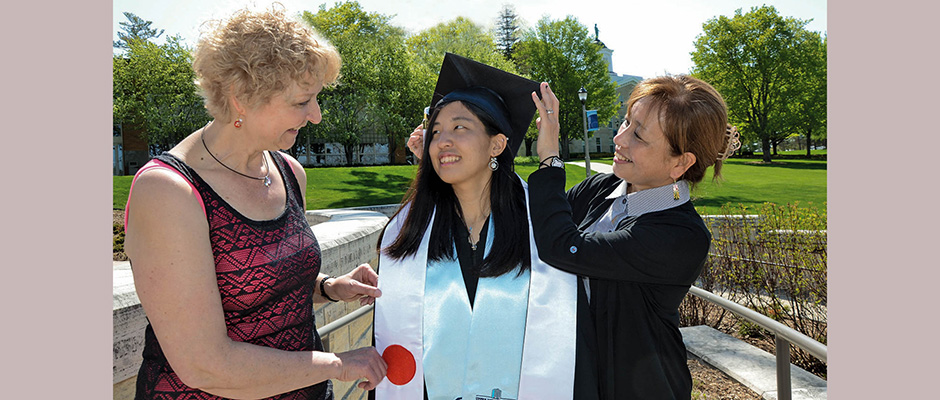 Prior to the May 7 Commencement ceremony on the Fayette campus, Saki Kawabata received a helping hand from her mom, Yumi, and her mother's pen pal of 44 years, Anita Kobza, of Meridian, Idaho.