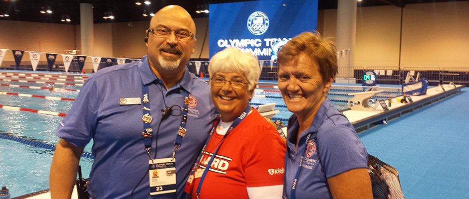Alumna Kathy Guyer '08 (center) served as a lifeguard at the recent U.S. Olympic Trails in Omaha, Neb. Guyer is pictured with lifeguard supervisors Dave Harris and Dayle Nervig.