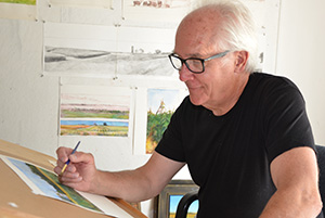 "Upper Iowa University alumnus Mark Haltof '71 is pictured last fall while working as an artist-in-residence at Fayette Campus. The Maine artist will feature his completed works at Bing-Davis Memorial Gallery during the University's ""Blue Pride Worldwide"" 100th Homecoming celebration."