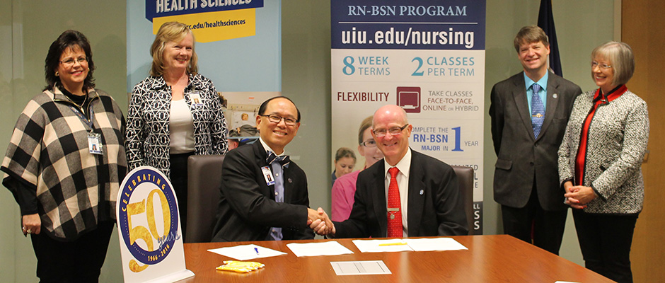 "Upper Iowa University and Northeast Iowa Community College signed a Memorandum of Understanding on Nov. 4 that will create a new Nursing Concurrent Enrollment Program (CEP) for students. Pictured signing the agreement are (L-R): NICC Vice President of Learning and Student Success Dr. Kathy Nacos-Burds, NICC Director of Nursing Susan Schneider, NICC President Dr. Liang Chee Wee,  UIU President Dr. William R. Duffy, UIU Dean of the School of Science and Mathematics Dr. Rich Bleil and UIU Director of Nursing Dr. Virginia ""Ginny"" Wangerin."