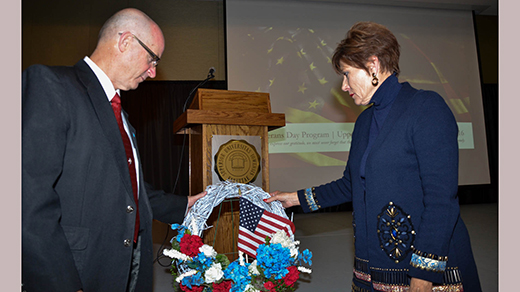 President William R. Duffy and his wife, Sharon, presented a wreath in memory of the nation's veterans during the Friday, November 11, program on Fayette Campus.