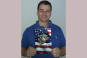 Chris Pascale '11 displays his recently published War Poems: A Marine's Tour 2003-2008.
