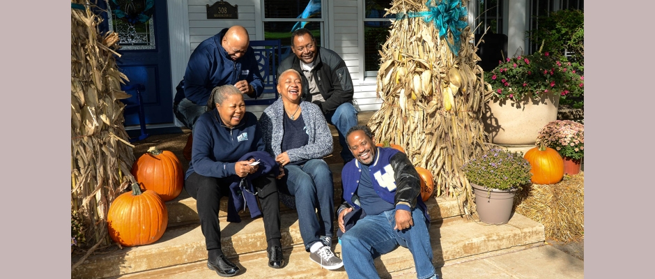 Memories and laughter quickly came to the forefront when Brotherhood members (seated, l-r) Celestine Clark '76, Donna Hartman '75, Ezekiel (Zeke) Morris '76; (kneeling) Arthur Blakely '76 and Milton Sivels '76 gathered together for a photo on the steps of the President's House during Homecoming 2016.