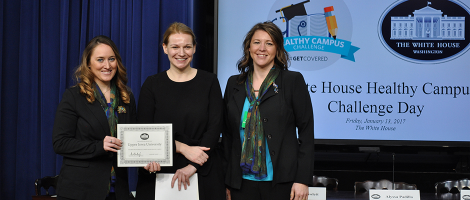Outgoing Assistant to the President and Deputy Chief of Staff for Implementation Kristie Canegallo (center) presented the Healthy Campus Challenge certification to UIU Director of Counseling and Wellness Crystal Cole (left) and UIU Director of Career Development Hope Trainor during ceremonies at the White House on Friday.